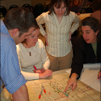 students being shown something on a design plan