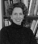 balck and white photograph of lisa naughton in front of books