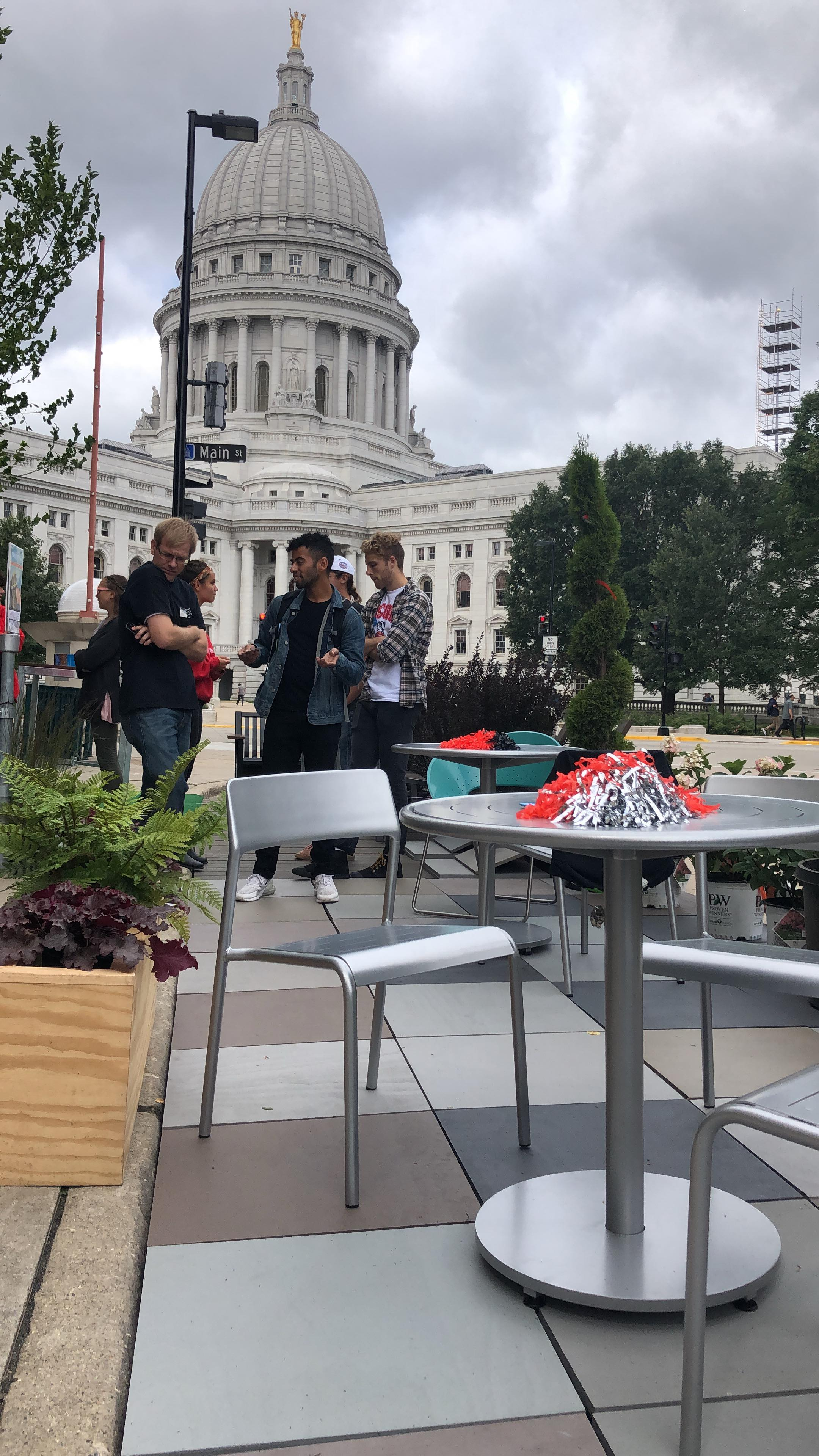 Landscape Architecture students socialize at Parking Day location near the Wisconsin State Capital